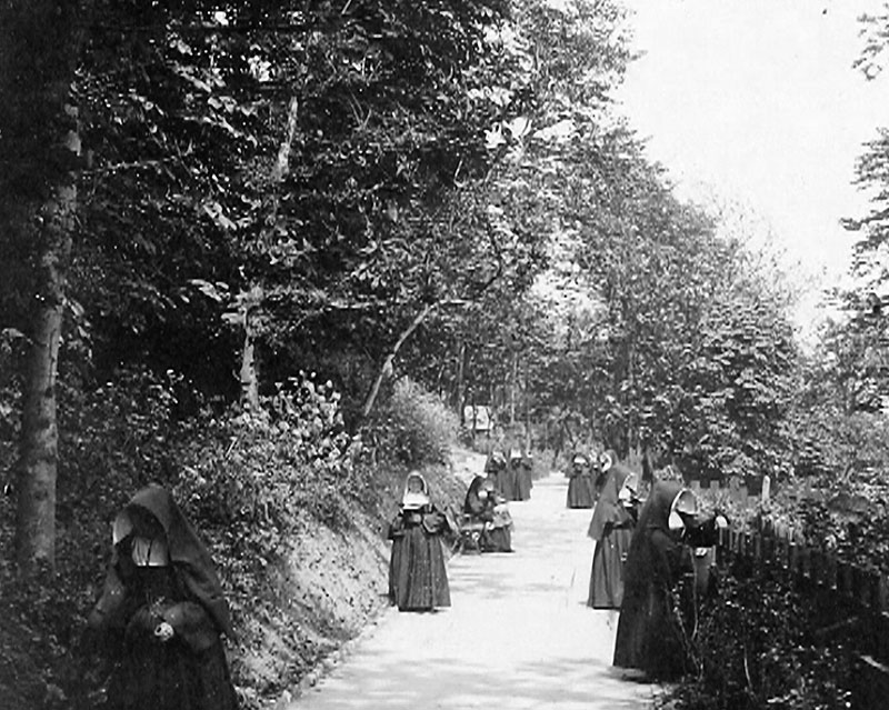 Nuns of the Order tending to the grounds.